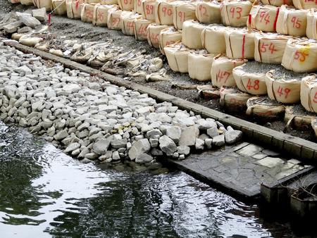 seawall: Seawall repair work of dilapidated river