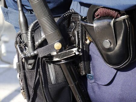 handcuffs: Police batons and handcuffs Stock Photo