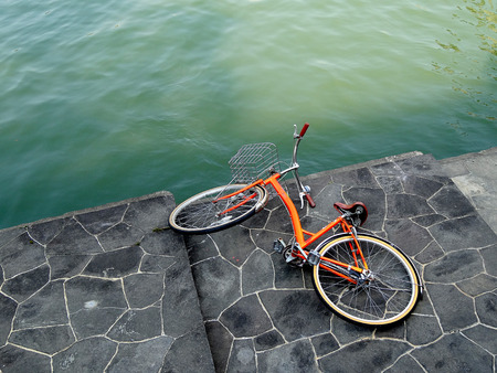 has been: Bicycle that has been dumped on the riverbank