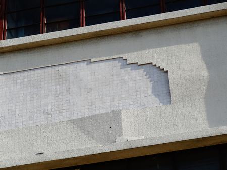 depreciation: Tile wall of detached building Stock Photo