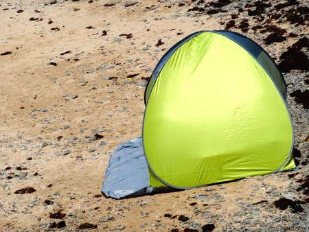 pitched: Leisure tent was pitched on the coast Stock Photo