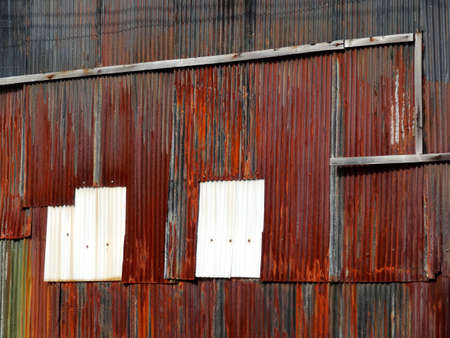 rusty: Rusty building of corrugated iron-clad Stock Photo