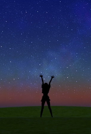hurray: Starry sky and female silhouette Stock Photo