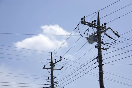 telephone poles: Telephone poles and wires