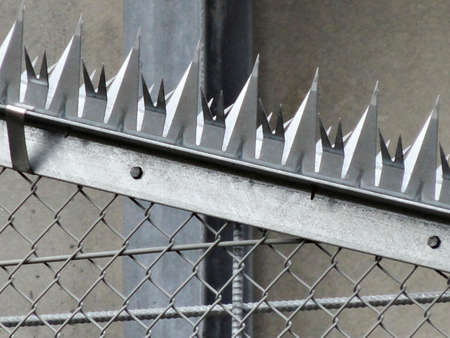 wire mesh: Of the entry ban wire mesh and metal thorn Stock Photo