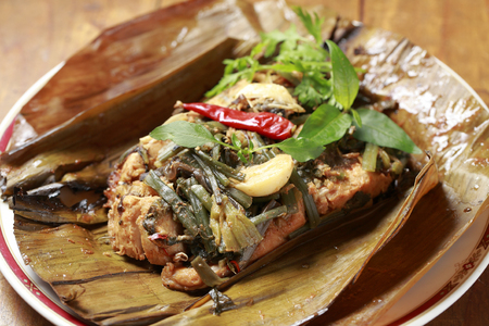 river fish: River fish wrapped steamed Myanmar Kachin cuisine Stock Photo