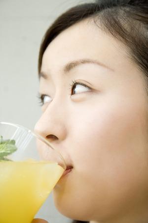 drank: Women who drank the juice Stock Photo
