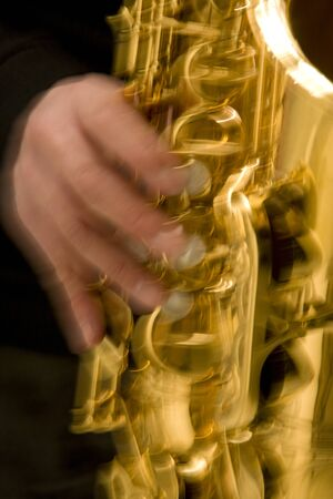 instrumentalist: Blurry photo of a man playing saxophone