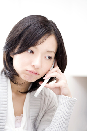 woman on phone: Woman talking on the phone Stock Photo