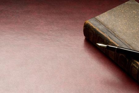 antique book: Antique book and pen Stock Photo