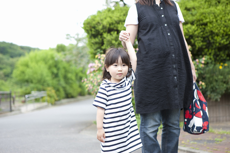 lifestyle shopping: Mom and stroll to girl Stock Photo