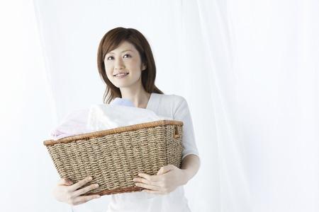 Washer woman with a basket. Reklamní fotografie