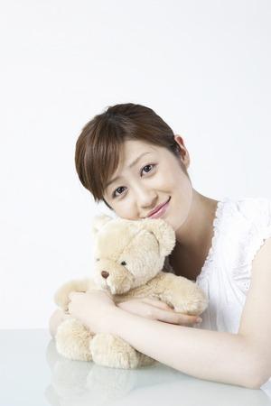 pleasure craft: Woman holding stuffed animal