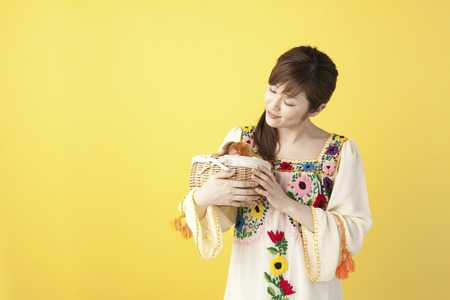 one piece dress: Women with containing basket of bread Stock Photo
