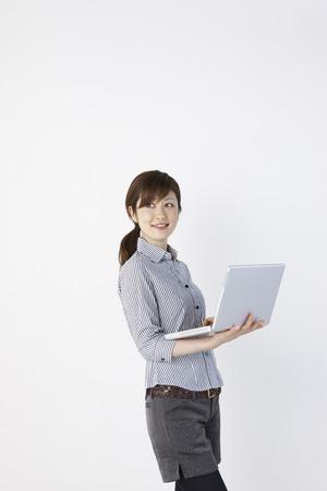 PC での女性 写真素材