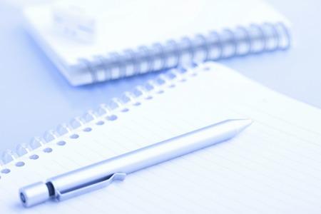 writing utensil: Ballpoint pen and notebook