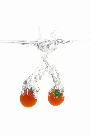 entered: moment that cherry tomatoes entered the water Stock Photo