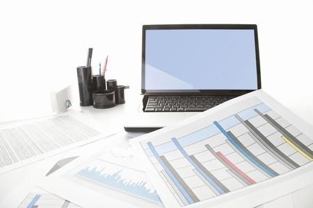 Laptop with charts Stock Photo