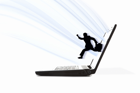 note pc: Businessman jumping out from laptop screen