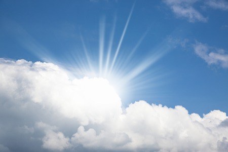 Towering cloud in summer and the Sun