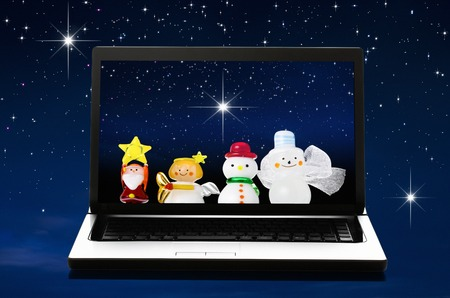 personal computer: Dolls of Christmas reflected in the personal computer