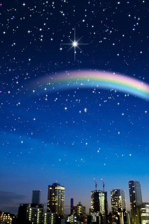Starry sky and the streets consuming rainbow Stock Photo