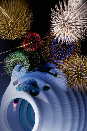 coil: Fireworks and mosquito coil Stock Photo