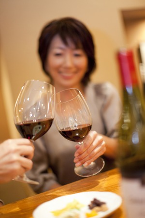 Couple to toast with red wine