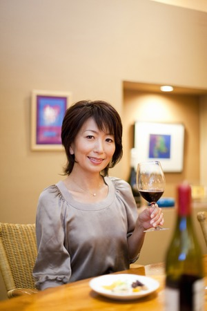 bar counter: Woman drinking wine at the BAR counter