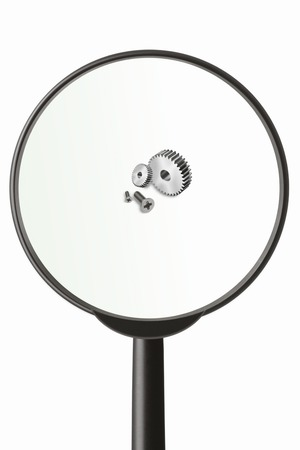 miniaturization: Magnifying glass and parts Stock Photo