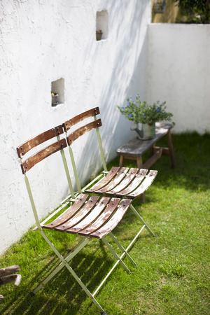 laid back: Chair placed in the garden