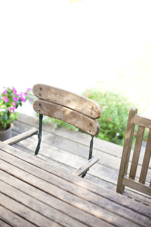 laid back: Chairs and tables placed in the garden of the wood deck