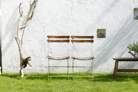 wall light: Chair placed in the garden
