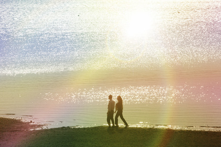 state of mood: Couples walk the lakeside Stock Photo