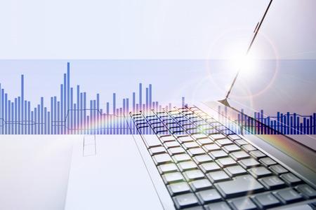 グラフとノート パソコン 写真素材