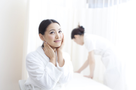 oriental bathrobe: Women wait for esthetic treatment