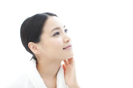 頬に手と一緒に伴われる女性 写真素材