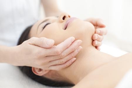 esthetician: Facial massage Stock Photo