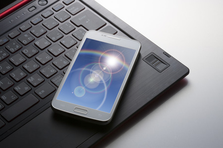 internet terminals: Smartphone and laptop Stock Photo