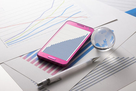 materials: Smartphones and graphic materials Stock Photo