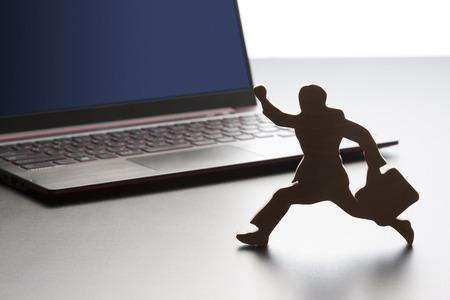 weaker: Businessman and laptop