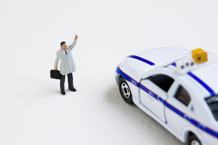 salaried: Miniature of salaried workers to stop the taxi