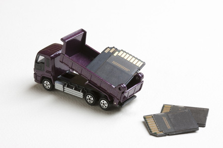 dispose: Dump truck in miniature to dispose the memory card Stock Photo