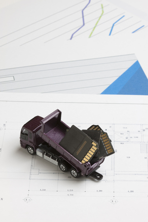 memory card: Dump truck in miniature to dispose the memory card Stock Photo