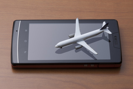 furlough: Smart phones and airplanes Stock Photo