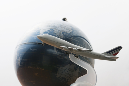 foreign country: Airplane and globe