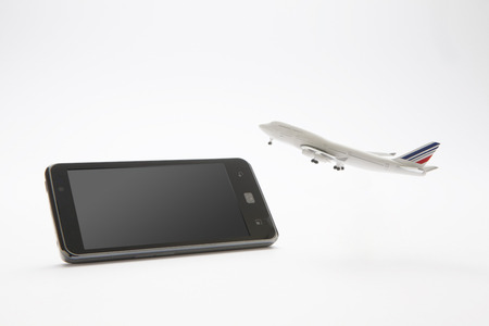 foreign country: Smart phones and airplanes Stock Photo