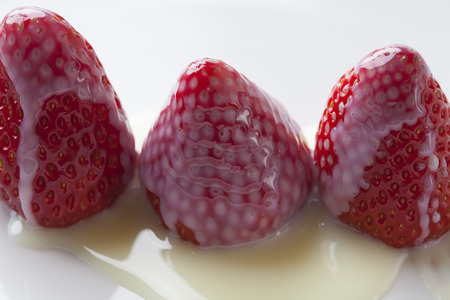 condensed: Condensed milk Strawberry Stock Photo