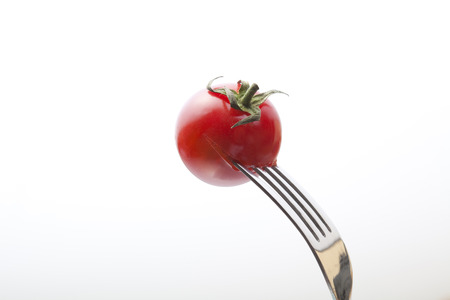 stabbed: Tomatoes stabbed to fork