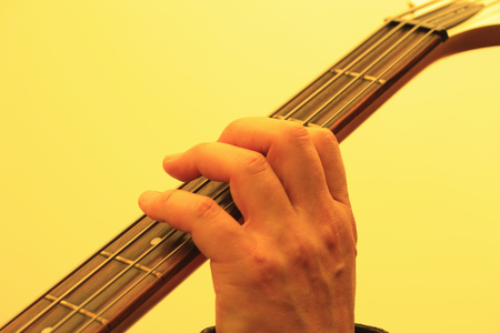 chords: Playing the guitar Stock Photo